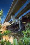 View from underneath autoroute and waterfall. Spanish motorway bridge from low angle waterfall stock photo