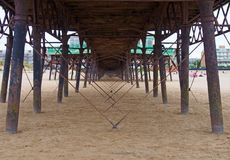 View underneath the pier showing metal supports and structure on the beach in lytham saint annes in lancashire stock images