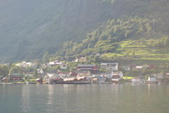 View of the Undredal. The city at the base of the mountain on the banks of the fjord Royalty Free Stock Photo