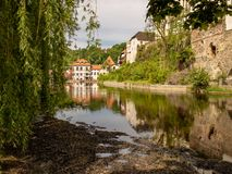 View of the Unesco World Heritage City Český Krumlov. In the Czech Republic with historic buildings, churches and narrow streets in front of blue sky stock images