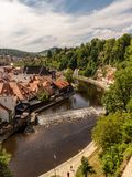 View of the Unesco World Heritage City Český Krumlov. In the Czech Republic with historic buildings, churches and narrow streets in front of blue sky royalty free stock images