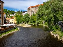View of the Unesco World Heritage City Český Krumlov. In the Czech Republic with historic buildings, churches and narrow streets in front of blue sky royalty free stock photos
