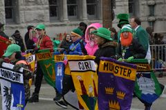St. Patrick`s Day Parade 2017 Flag presenters. A view of the Union Station Hotel just before the parade began  Presenter of cities and townships Stock Images