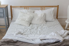 View of an unmade crumpled bed Stock Image