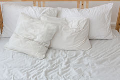 View of an unmade crumpled bed Stock Photo