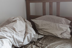 View of an unmade crumpled bed Royalty Free Stock Photo