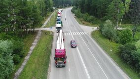 View from a quadrocopter, a column of trucks without movement, shipping, road, highway, without camera movement.