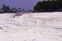 View of the unusual salt white mountain, thermal springs and tourists stock images