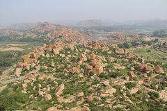View of the unusual stone landscape and the ruins of Hampi from the hill Matanga. Sacred Center. Karnataka. India. View of the unusual stone landscape and the royalty free stock image