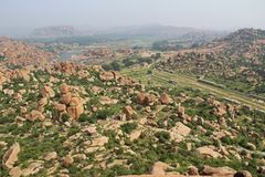 View of the unusual stone landscape and the ruins of Hampi from the hill Matanga. Sacred Center. Karnataka. India. View of the unusual stone landscape and the royalty free stock photo