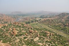 View of the unusual stone landscape and the ruins of Hampi from the hill Matanga. Sacred Center. Karnataka. India. View of the unusual stone landscape and the stock photos
