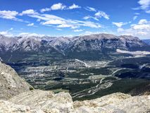 A view from up above of the beautiful town of Canmore, nestled in a valley in the Rocky Mountain range. royalty free stock photography