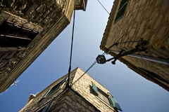 View up high on old stone houses and blue sky Stock Photo