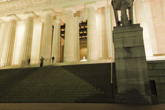 View up the lower and upper steps of the Lincoln Memorial towards the illuminated Central Chamber, National Mall, Washington DC. Grand view up into the Stock Photography