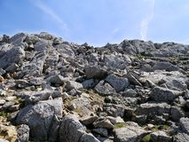 View up rocky incline with small cairn on top Stock Photography