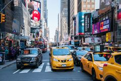 View up a very crowded avenue during rush hour in Manhattan New York City showing heavy traffic and crowds of people royalty free stock image