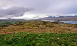 View of upland fields in Scotland. View of upland fields, barren landscapes, the ocean, and hills on the island of Jura, as seen from the Island of Islay royalty free stock images