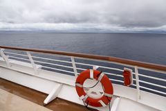 View from upper deck of modern cruise ship showing lifesaver Stock Photos