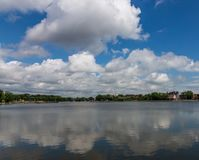 View of the Upper Pond and clouds reflected in it, Kaliningrad, Russia stock photography