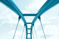 View of the upper structure of the turquoise bridge against the blue sky stock images