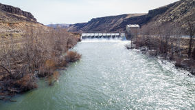 View upstream on the Boise river reveling a Diversion Dam. Wild Boise river dirring the spring runoff high water stock image