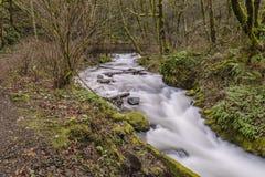 View upstream towards Bridal Veil falls. View towards bridge with person on it at Bridal Veil falls Royalty Free Stock Image