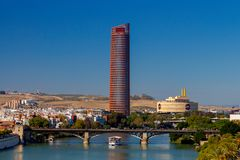 Sevilla. City embankment along the Guadalquivir. View of urban embankment in Seville along the Guadalquivir river by day. Spain. Andalusia royalty free stock images