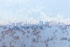 View of urban houses through snow-covered window Royalty Free Stock Photography