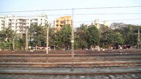 View on urban landscape during the train ride in Mumbai. stock footage
