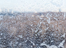 View of urban park through the snow-covered window Stock Photos