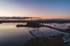 View of the urban sunset with traffic on the highway, Espoo Finland. View from the sky of the urban sunset with traffic on the highway, Espoo Finland royalty free stock image