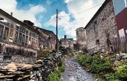 View of Ushguli village. Ancient svan towers in Ushguli village at autumn morning in the Caucasus mountains. Upper Svaneti, Georgia, Europe. October 2015 Stock Photos