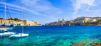 View Valetta with sailing boats in turquoise sea. Panoramic view of Valetta with sailing boats in turquoise sea. Malta Stock Image