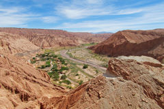 View on valle Quitor, San Pedro de Atacama. Desert. Panoramic view of empty dry solty desert soil in SanPedro de Atacama. Red rocks in driest area in the world royalty free stock image
