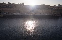 View of Valletta city in Malta with lens flare effects. Mediterranean sea and sunny summer day Royalty Free Stock Images