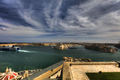 View on Valletta Grand harbor from the historic Upper Barraka garden area in Malta with historic line of cannons-Saluting Battery. View on Valletta Grand harbor Royalty Free Stock Photography