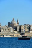 View of Valletta, Malta. View of Valletta city buildings and waterfront seen from Marsamxett Harbour with a tour boat in the foreground, Valletta, Malta, Europe Royalty Free Stock Images