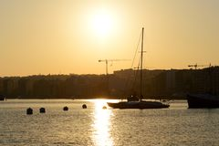 The view on Valletta and sail yacht in sunset. Sliema, Malta Royalty Free Stock Photo