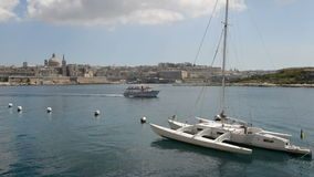 The view on Valletta and sail yacht with Ukrainian flag and cruise yacht with tourists. Sliema, Malta stock footage