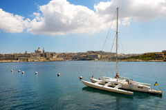 The view on Valletta and sail yacht with Ukrainian flag. In sunset, Sliema, Malta Stock Images