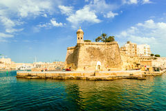 View of Valletta with watch tower and Gardjola Gardens. In Senglea from the sea, Malta Royalty Free Stock Image