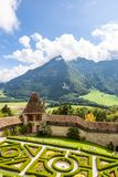 View of the valley, alpine mountains and cloudy sky from Castle Gruyeres, Switzerland stock photo