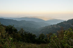 View of a valley in a beautiful early morning with fog between h Stock Image