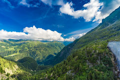View of the valley behind Emosson Dam and Mont-Blanc peak on horizon near Swiss village of Finhaut Stock Photography
