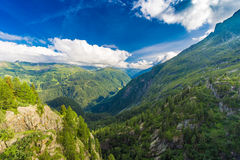 View of the valley behind Emosson Dam and Mont-Blanc peak on horizon near Swiss village of Finhaut Royalty Free Stock Photos