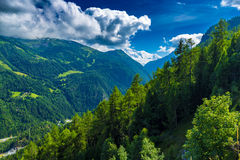 View of the valley behind Emosson Dam and Mont-Blanc peak on horizon near Swiss village of Finhaut Royalty Free Stock Images