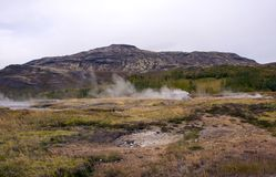 View of the valley of geysers, hills and mountains, smoking sources royalty free stock images