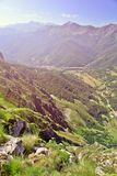 View of the valley from mountain top in summer day. Vicinities of Fuente De in Spain, it is toned Stock Images