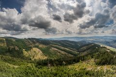 View of the valley in a mountainous area. Mountains against a cl royalty free stock photos