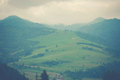 View on valley in mountains in fog Royalty Free Stock Photos